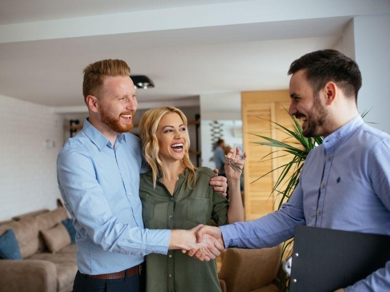 Financial advisor greeting homeowners